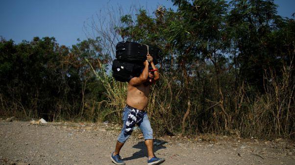Nearly quarter-million Venezuelans sought asylum in 2018, UNHCR says