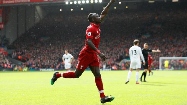 Firmino and Mane sink Burnley to keep Liverpool in the race