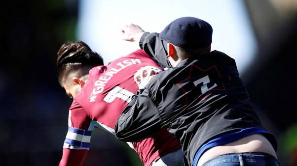Pitch invader punches Villa's Grealish in derby win at Birmingham