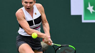 Halep claims tough win over qualifier Kozlova