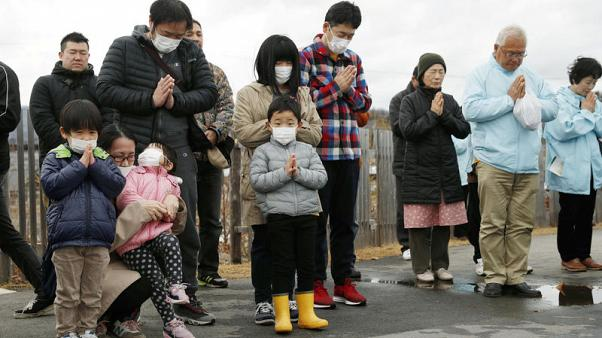 Bells and sirens as Japan marks tsunami anniversary, pledges recovery