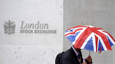 FTSE 100 buckles as sterling rallies on May's Brexit breakthrough