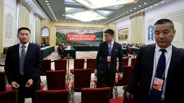 China says Xinjiang has 'boarding schools', not 'concentration camps'