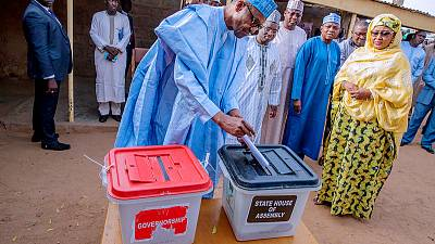 Nigeria's ruling party takes close lead in governor elections, but balance could tip
