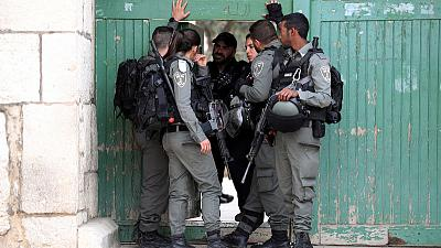Unrest at Jerusalem holy site and two Palestinians killed in West Bank