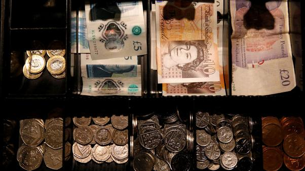 Pound edges up after May's Brexit defeat, more volatility expected