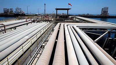 Oil firms as Saudis trim exports, U.S. output forecast reduced