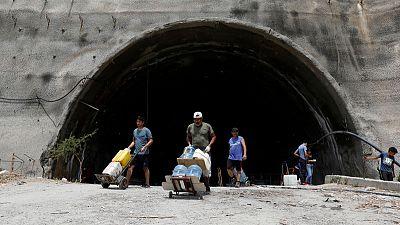 Venezuela seeks to restore power amid looting; China offers help