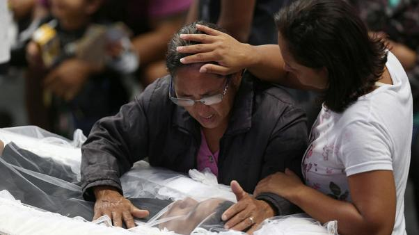 Brazil city burying eight victims of school attack