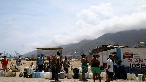 Four dead, hundreds detained after Venezuela blackout - rights groups