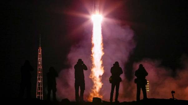 Russian space rocket lifts off with astronauts who survived rocket failure
