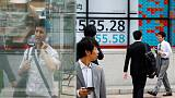Asian stocks up as Sino-U.S. trade talks in focus, dollar supported