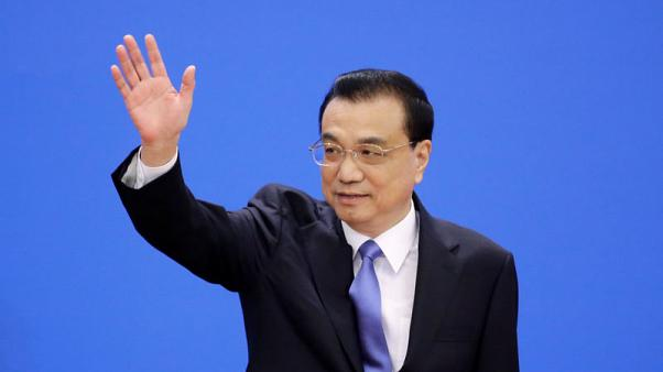 China will follow through on new investment law, premier pledges