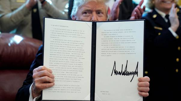 Trump vetoes lawmakers' measure against border wall