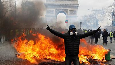 Parisians clean up after more weekend rioting on Champs Elysees