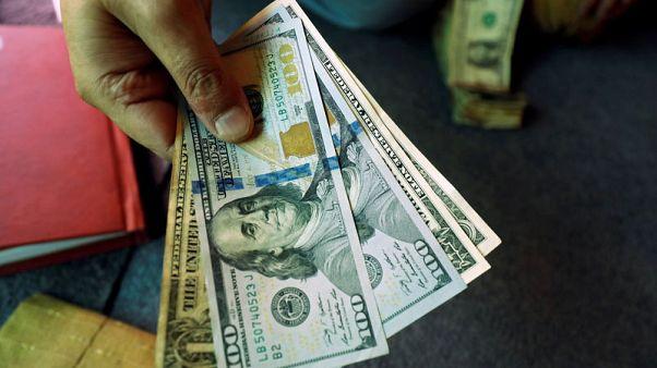 Dollar licks wounds after soft data fans bets on dovish Fed