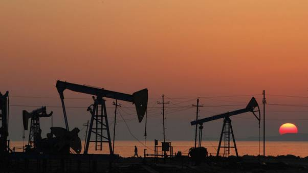 Oil eases on economic worries, but OPEC-led cuts support