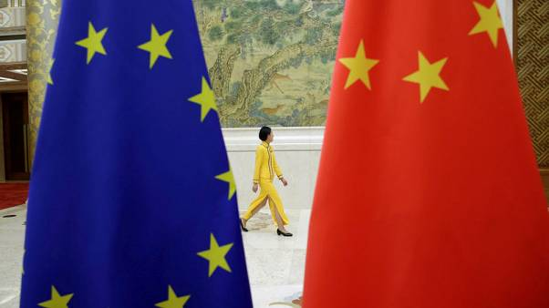 EU to push China to open economy at April summit - draft statement