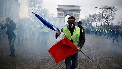 French President Macron considers banning protests on Champs Elysees - official