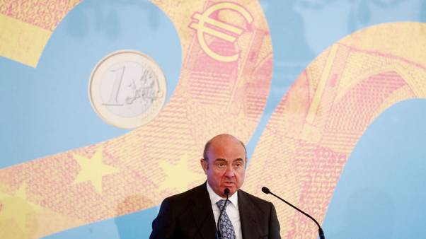 De Guindos toes ECB's line with cautious message on economy