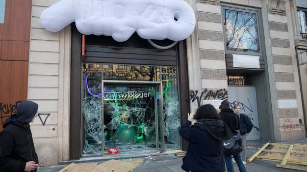 On Paris' Champs Elysees, shattered glass and smoking ruins