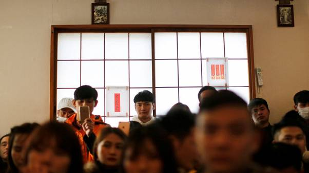 Vietnamese workers, streaming to Japan, face risks as labour system opens up
