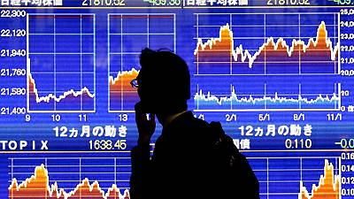 Asian shares steady ahead of Fed meeting; May's Brexit deal in chaos