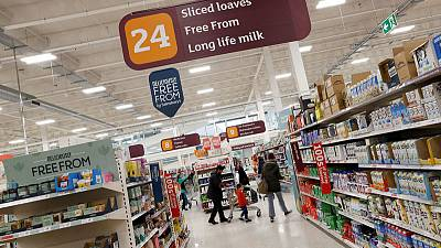 Sainsbury's-Asda pledge 1 billion pounds of price cuts to salvage deal