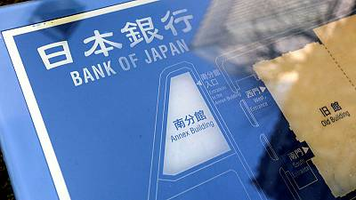 Japan government downgrades economy view as U.S.-China trade war bites