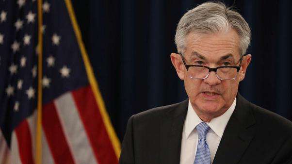 Fed sees no rate hikes in 2019, plans balance sheet reduction slowdown