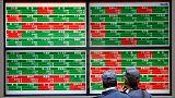 Dovish Fed shift lifts Asian shares, dollar nurses losses
