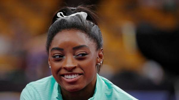 Gymnastics - U.S. team heading in positive direction from dark place, says Biles