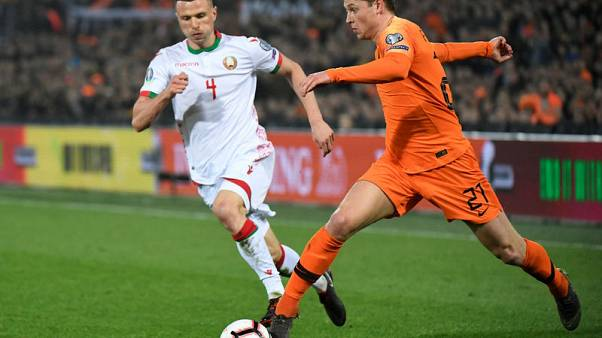 Depay double leads Netherlands to easy win over Belarus