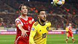 Belgium overcome Courtois howler to sink Russia