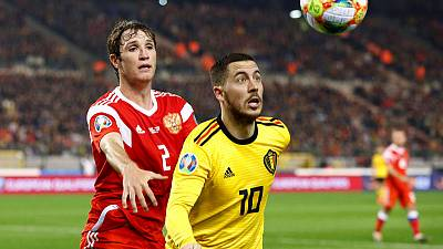 Belgium overcome Courtois howler to sink Russia