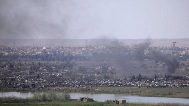 Trump says all Islamic State land lost in Syria, SDF says fight continues