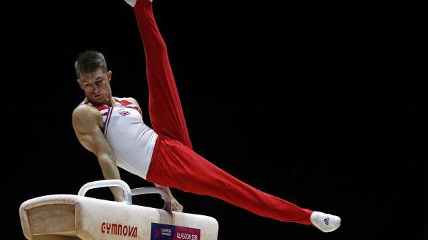 Gymnastics - Whitlock rues no perfect 10, mulls scoring changes