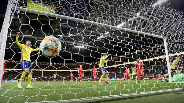 Classy Quaison steers Swedes to 2-1 win over Romania