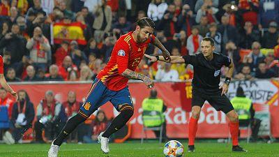Nerveless Ramos gives Spain winning start