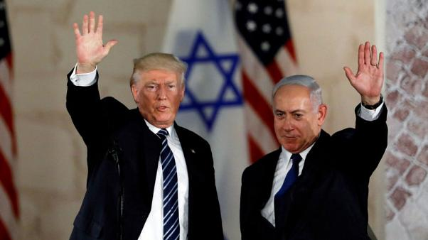 Israel's Netanyahu, in close election race, visits U.S. ally