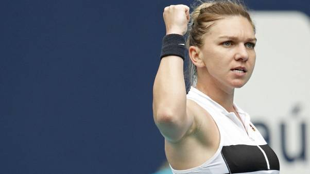 Halep recovers to beat Hercog, Venus wins in Miami