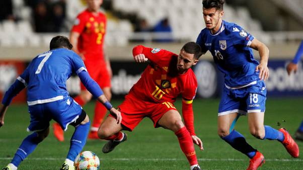 Hazard marks milestone with early goal to help Belgium win