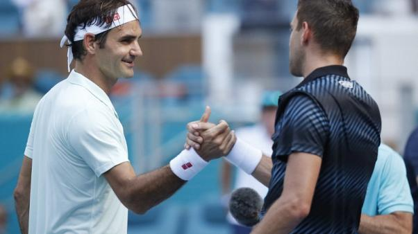 Federer, Anderson advance to fourth round in Miami