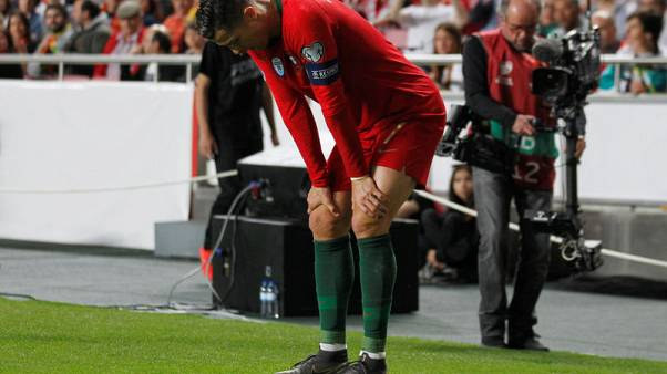 Serbia hold Portugal after Ronaldo suffers first-half injury