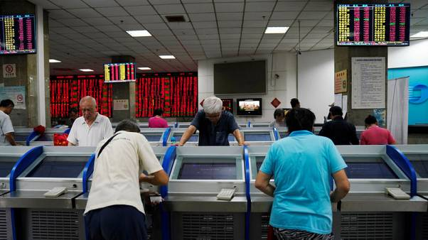 China stocks rally on investor optimism, but corporate earnings lag