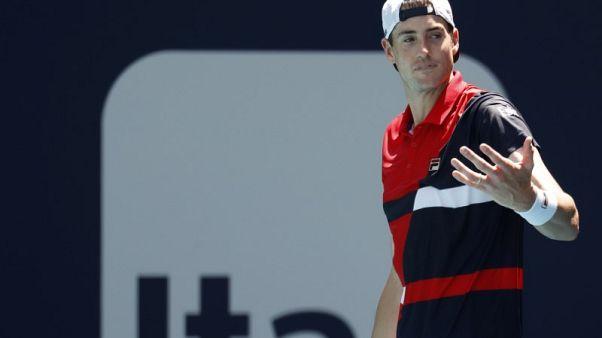 Tennis - Defending champion Isner into Miami quarters, Kyrgios out