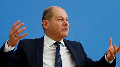 German finance minister says he's not pressuring Deutsche and Commerzbank to merge