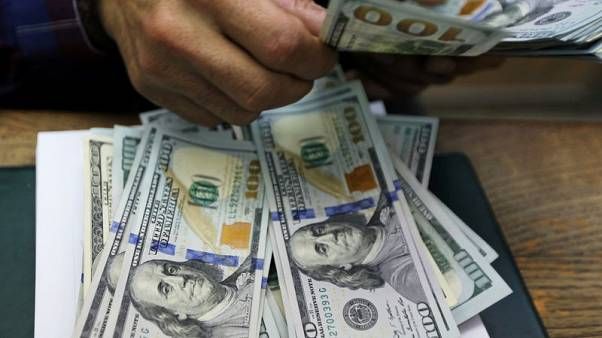 Dollar holds gains as risk appetite recovery arrests yield decline