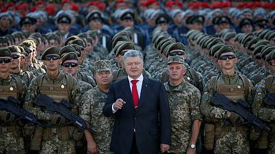 Ukraine's action man president faces voters' judgment