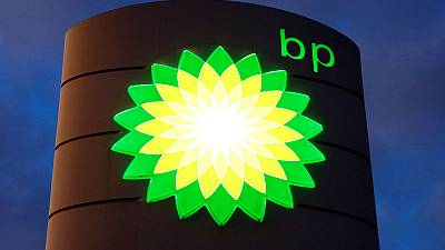 BP's 'for sale' sign covered by snow in Wyoming oil and gas field